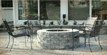 Raised patio and firepit with Techo-Bloc pavers